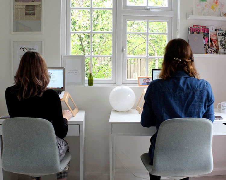 Carnsight Communications: photo of two women working on laptops