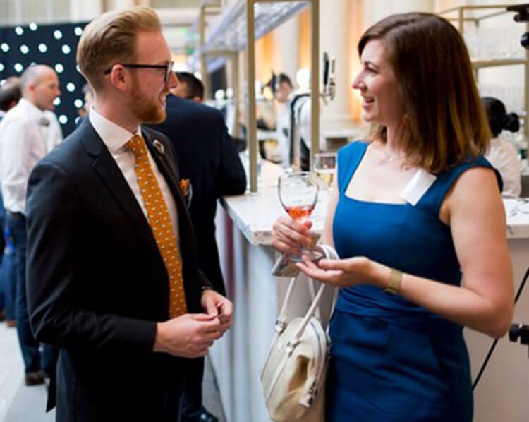 Photo of two people meeting at an event